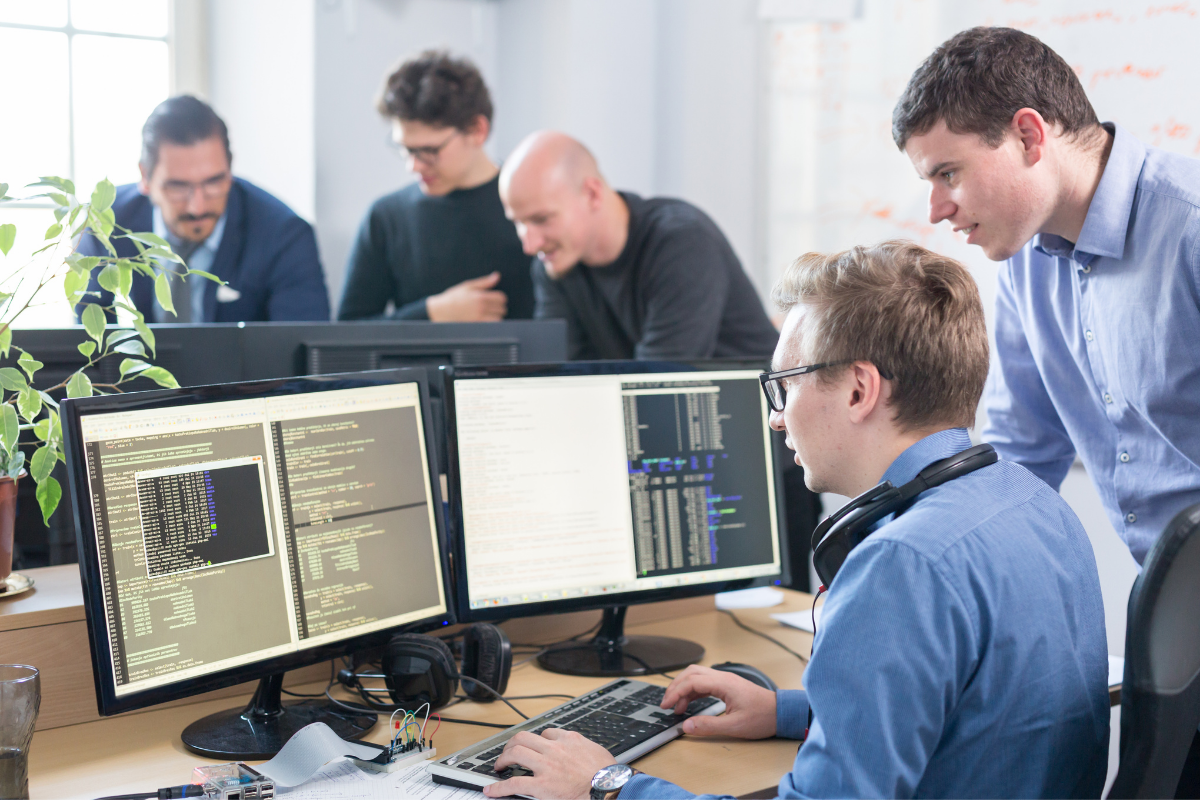 outsourcing-team-fixing-computer-code
