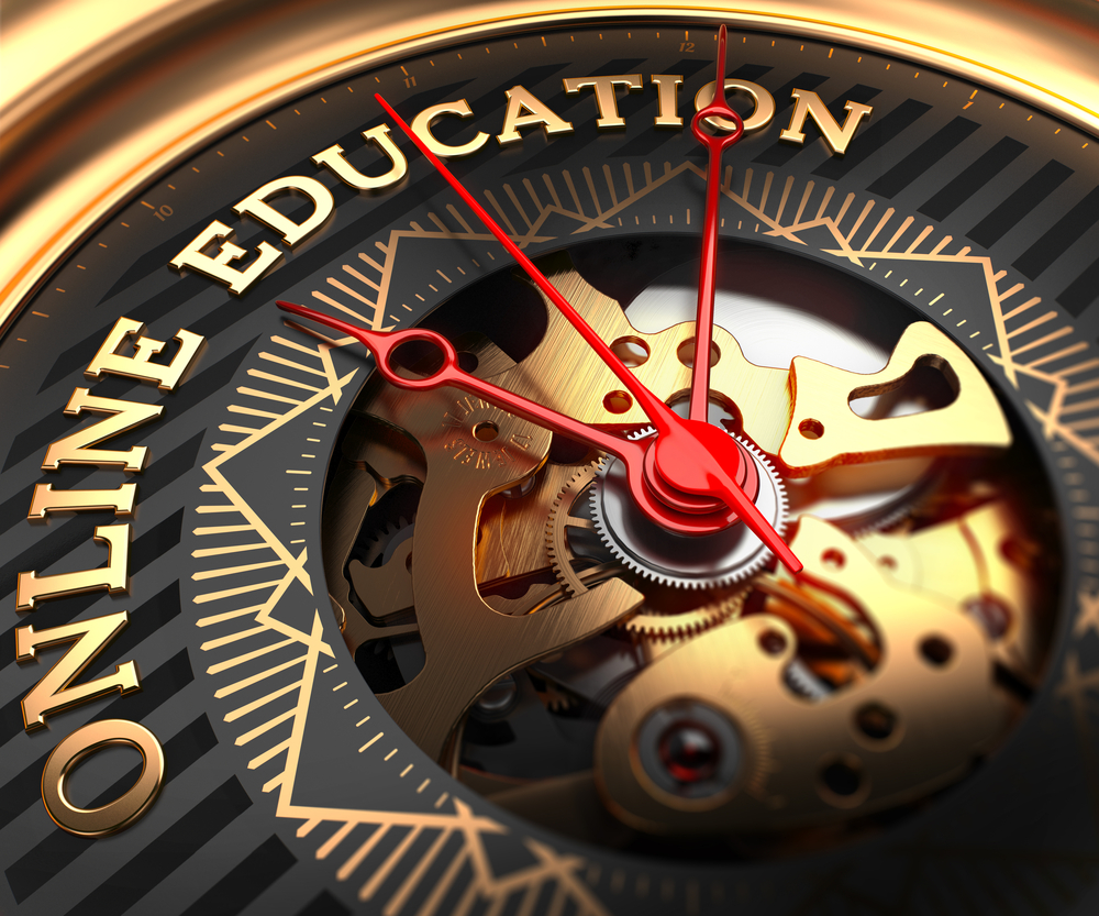 Online Education on Black-Golden Watch Face with Closeup View of Watch Mechanism.