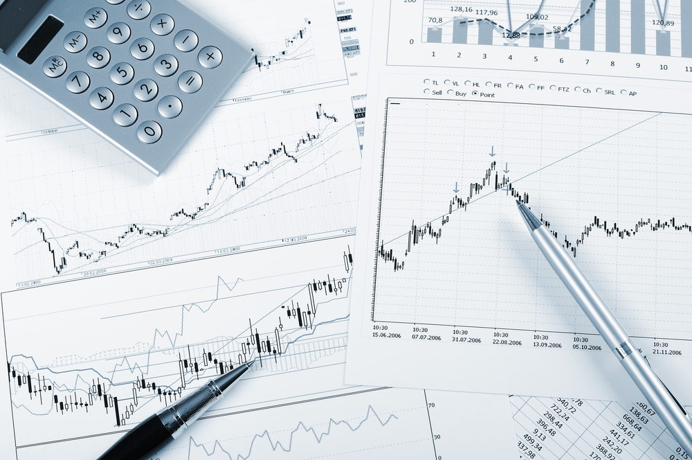 charts and graphs of sales of securities - workplace successful business man-1