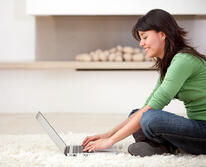 woman with a laptop working from home smiling